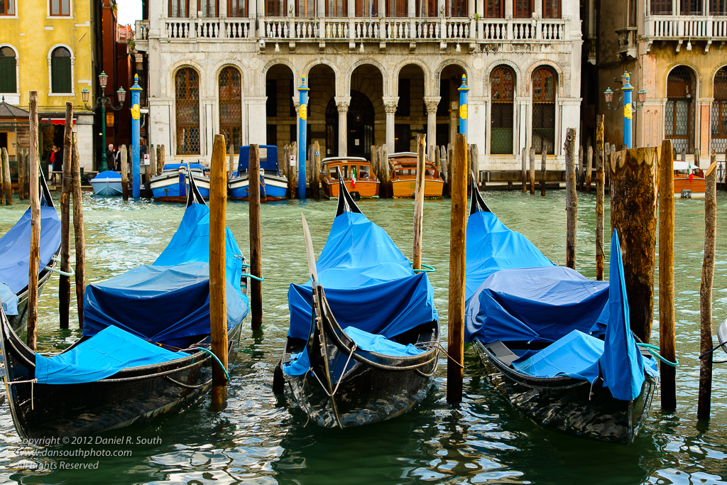 a photo of Gondolas Moored Near The Rialto Bridge venice