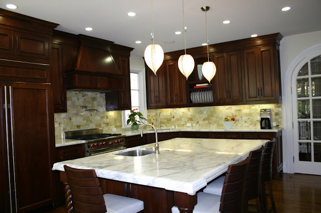 simple kitchen with white marble countertops
