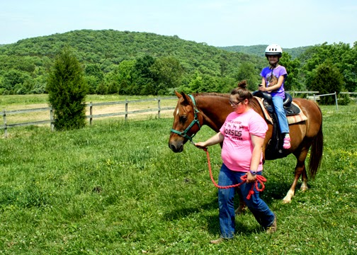 Tessa had a blast learning basic horsemanship at Camp Cedarledge. Although riding was limited to once around the barn, the Pony Tales program was so much more than that.