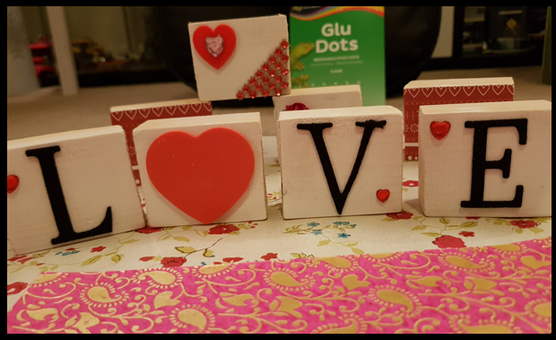 Using Lettering, glu dots and blocks to create Valentine Blocks