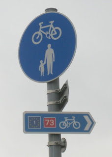 Bike route sign for EuroVelo 1 and National Route 73, near Newton Stewart, Scotland