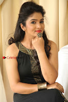 Kannada Actress Divya Uruduga Pos in Black Long Dress at Huliraaya Movie Audio Release Event  0011.jpg