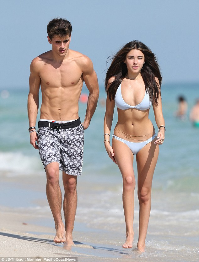 Justin Bieber's protege Madison Beer wows in skimpy bikini as she shares a sweet kiss with beau Jack Gilinsky