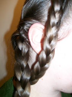 Front braid tucked under back braid.