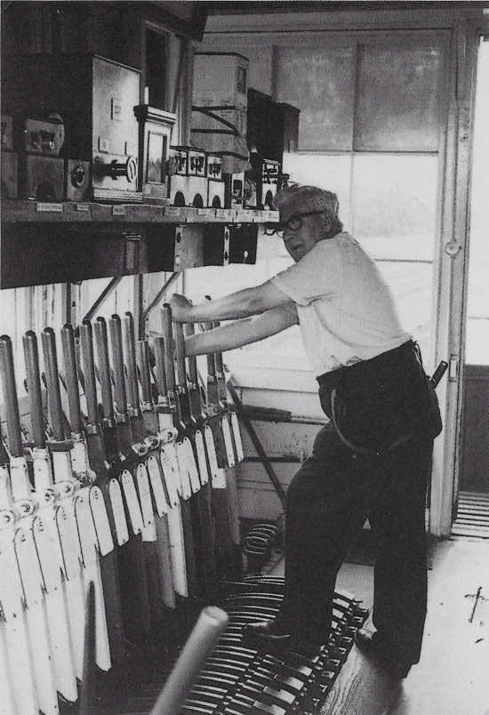 Photograph of Image 10 a to source: Inside Marshmoor signal box west side of the down line. Mr Alec Temple at the levers. This box controlled various sidings for the industrial site. July 1967