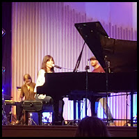 Ginny Owens at piano in concert