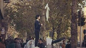 Iranian women protest compulsory cover-up