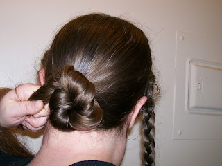 Winding the hair into a twist (bun).