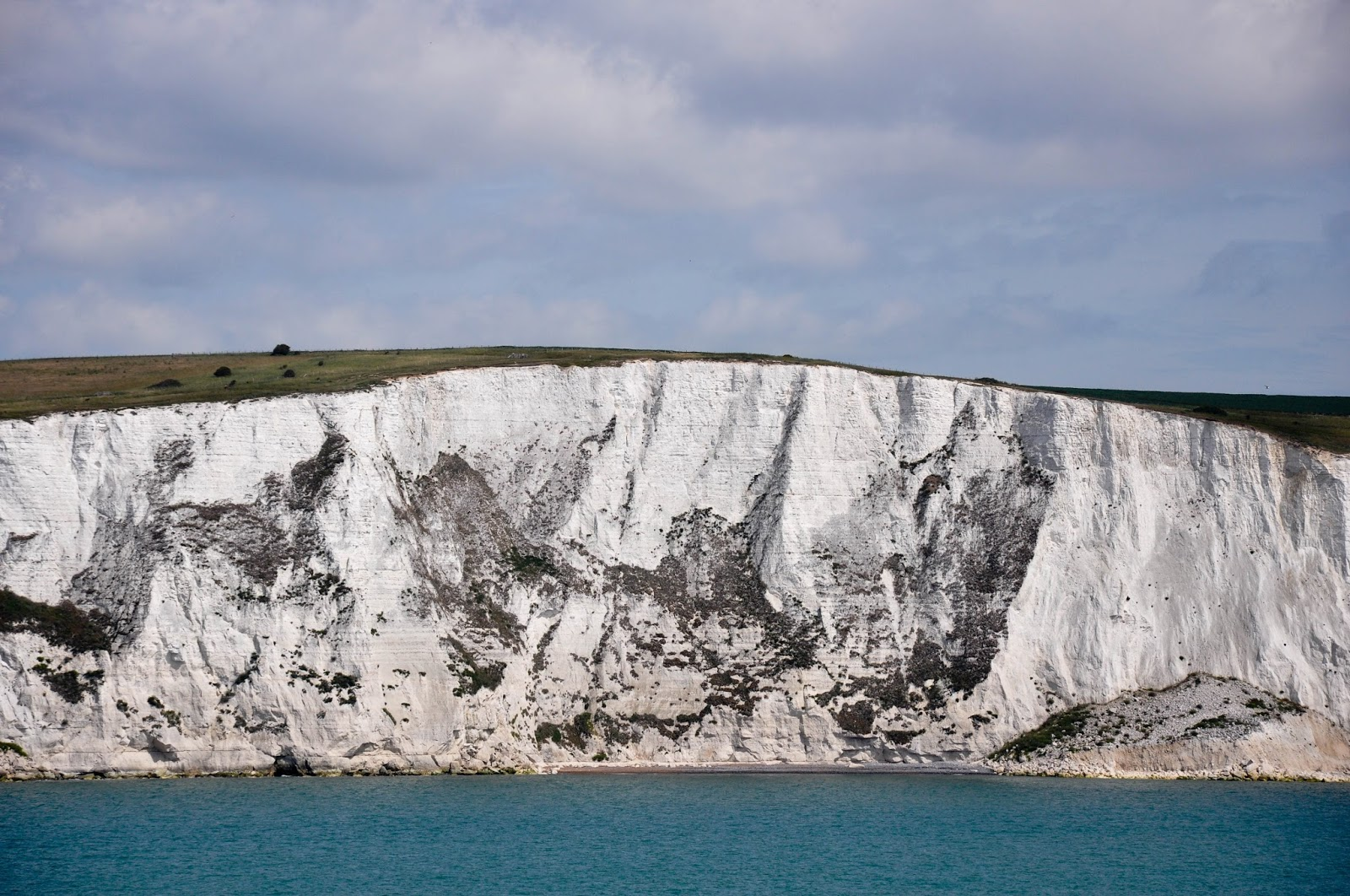 A close-up of the white cliffs of Dover seen from a DFDS ferry after crossing the English Channel back from France
