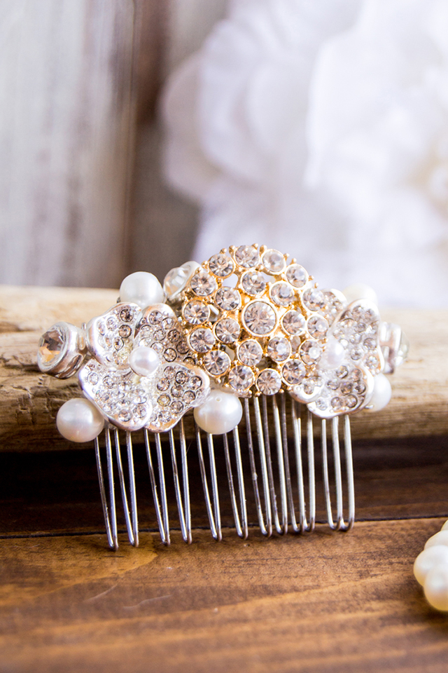 crystal hair comb on wood backdrop