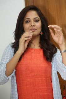Actress Anasuya Bharadwaj in Orange Short Dress Glam Pics at Winner Movie Press Meet February 2017 (54).JPG