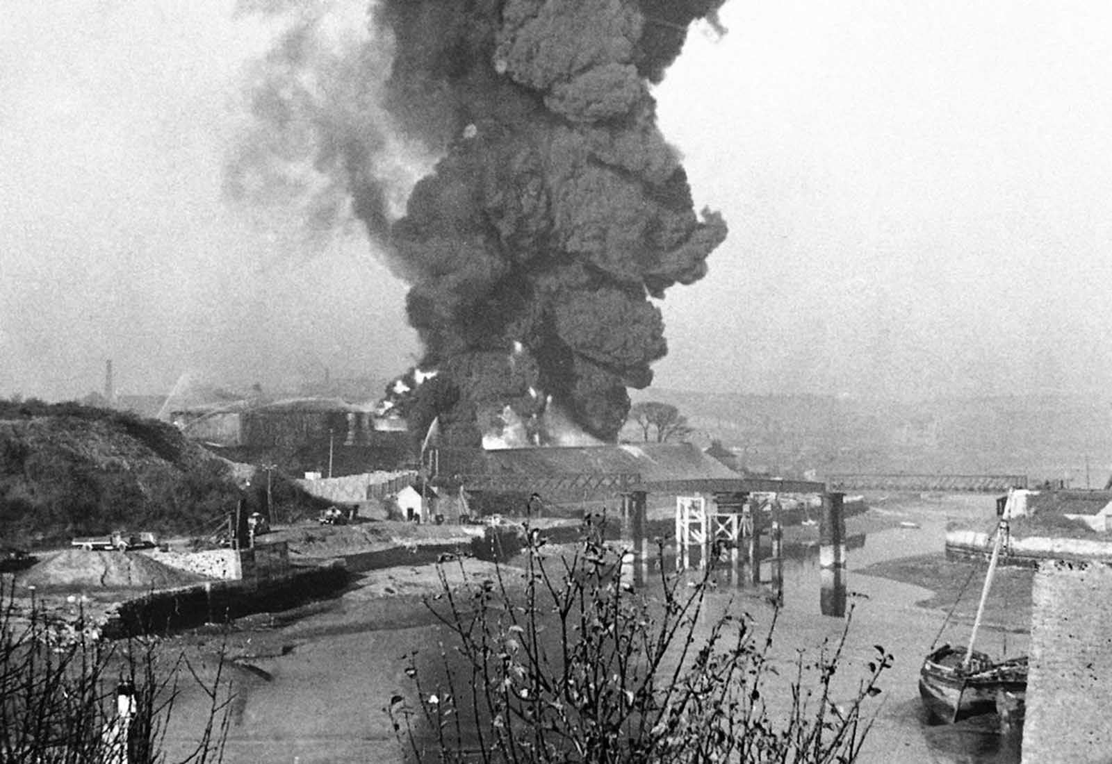 A great column of smoke billowing upward from a fire started at Plymouth, South West England, in November 1940, as a result of heavy enemy bombardment.