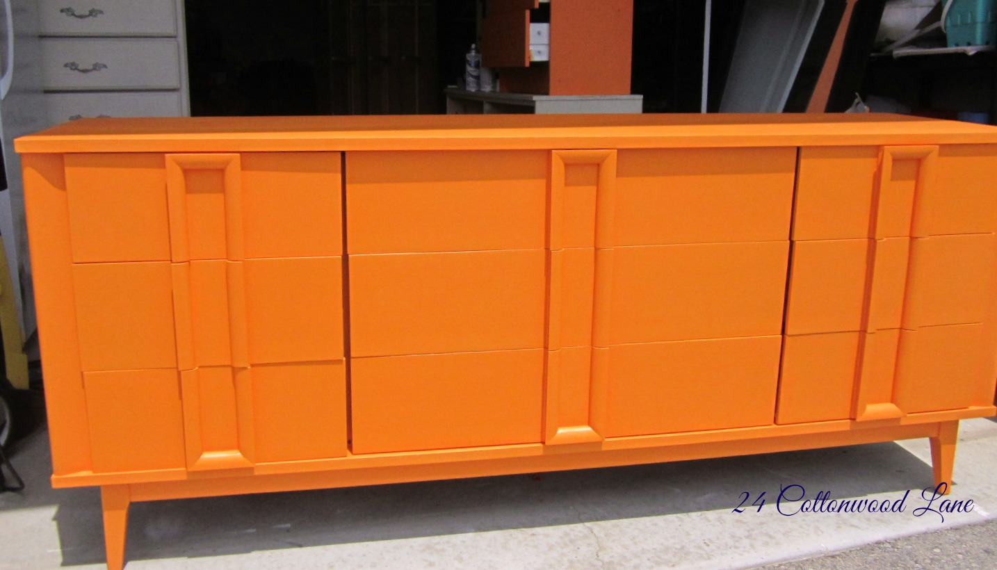 the groovy orange dresser - how gorgeous is this color i'm thrilled that it's going to a little boywho is having a woodlandhunting themed room thanks to his brave momma forletting