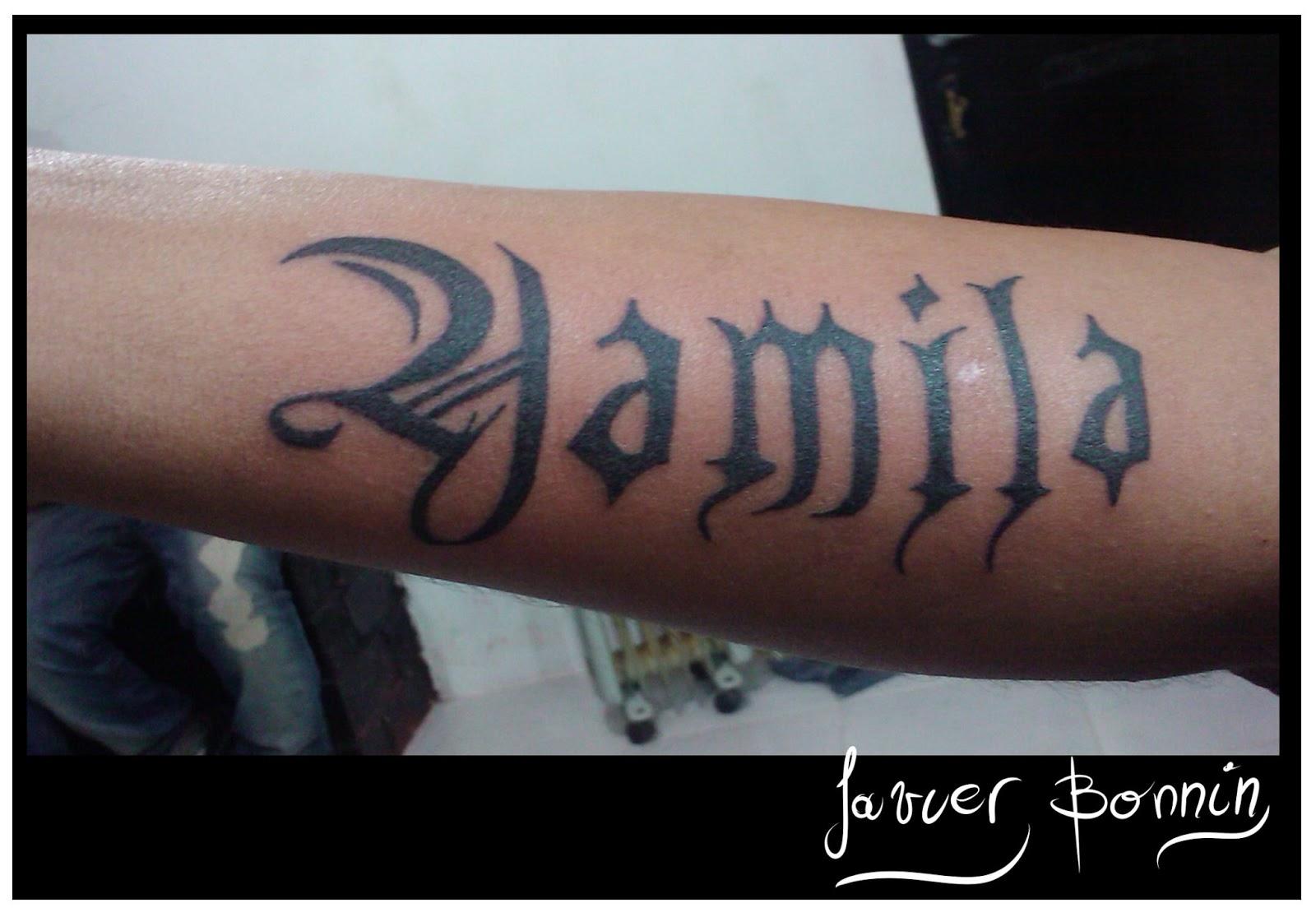Te Amo Escrito En Pluma En La Arena Imagen De Archivo: Javier Bonnin Tatuajes: Yamila Y Brian