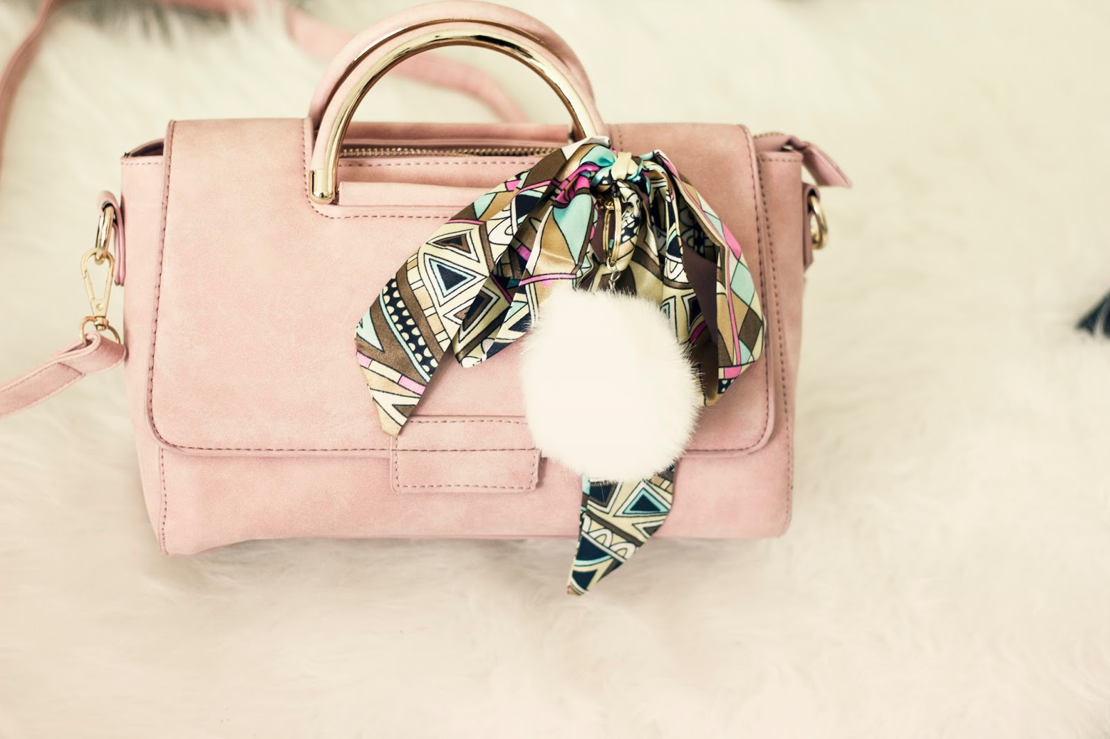 pink handbag with scarf ribbon and pompom