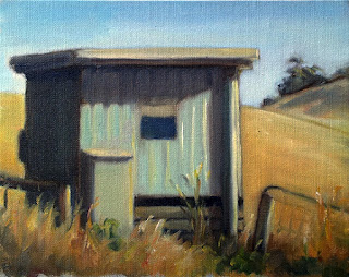 Oil painting of a small light-aqua-coloured shed surrounded by dry grass with distant rolling hills.