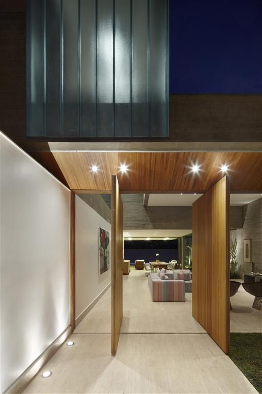Wooden doors in modern home by Anastasia Architects
