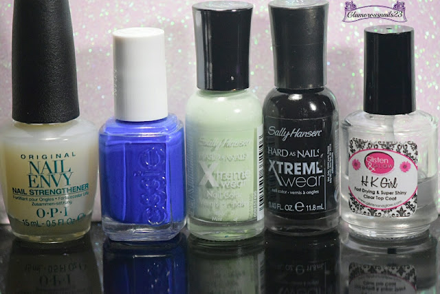 O.P.I. Original Nail Envy, Essie Butler Please, Sally Hansen Xtreme Wear Mint Sorbet, Sally Hansen Xtreme Wear Black Out, Glisten & Glow HK Girl Fast Drying Top Coat
