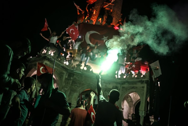 Turkish people chant slogans during a pro-government rally in Izmir