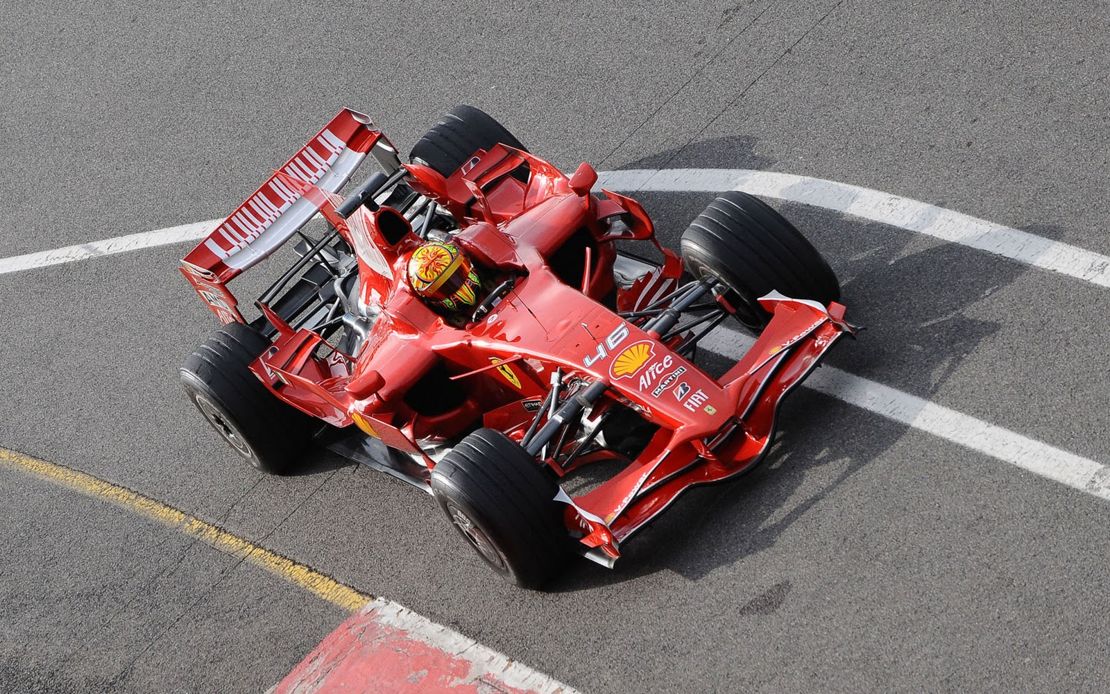 http://3.bp.blogspot.com/-m4N2ARe08zE/To80vt31knI/AAAAAAAAAH8/aslhJldVYhM/s1600/ferrari-rossi-test-f1-wallpaper-1.jpg
