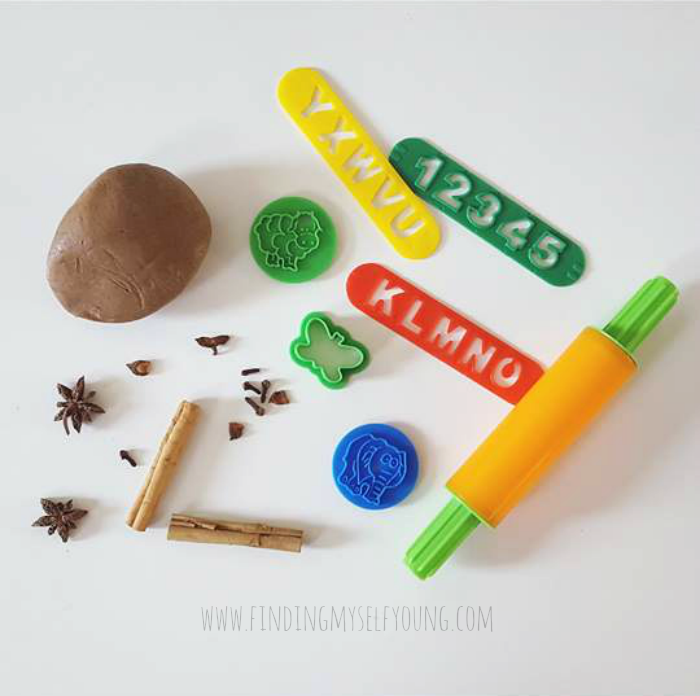 Gingernut scented playdough with nutmeg. Shape cutters, rolling pin and alphabet stencils.