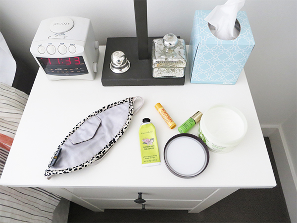 Some of Vancouver beauty blogger Solo Lisa's bedside necessities: Crabtree & Evelyn hand lotion and body butter, Burt's Bees lip balm, Tata Harper aromatherapy treatment.