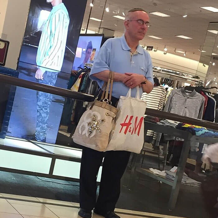 50 Hilarious Pictures Of 'Miserable Men' Waiting While Their Wives Were Shopping