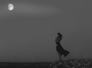 young-girl-hurt-be-loneliness-stands-in-moonlight-near-sea-rocks-image.jpg