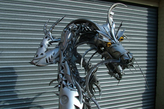 05-Chinese-Dragon-Ptolemy-Elrington-Hubcap-Creatures-and-other-Car-Parts-Animal-Sculptures-www-designstack-co