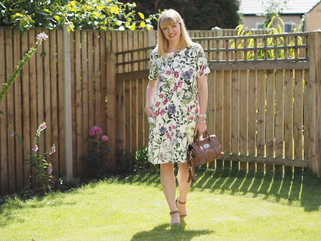 Ethical fashion Braintree botanical floral print dress with tan sandals and Mulberry bag. Over 4