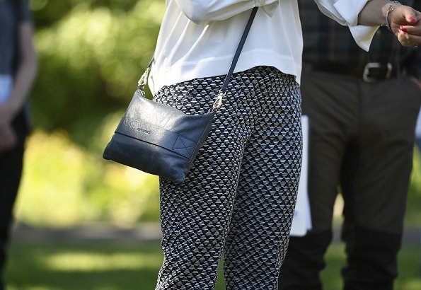 Crown Princess Victoria wore Stylein Baktun Trousers, silk blouse and carried HIPPI GRACE Bag at opening of Åsnens National park in Kronoberg, Åsnen Lake