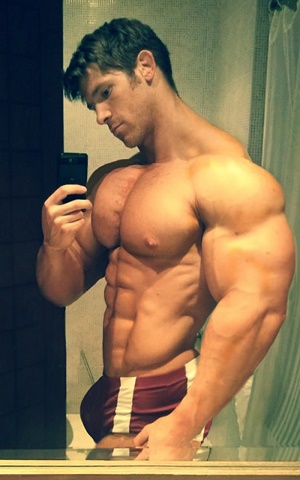 image Muscle guy playing with his cock