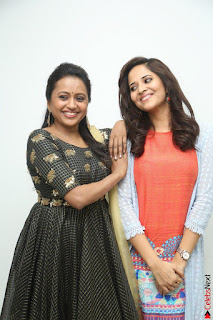 Actress Suma in Black Salwar Suit and Anusuya in orange Dress at winner movie press meet part 1 February 2017 (33).JPG