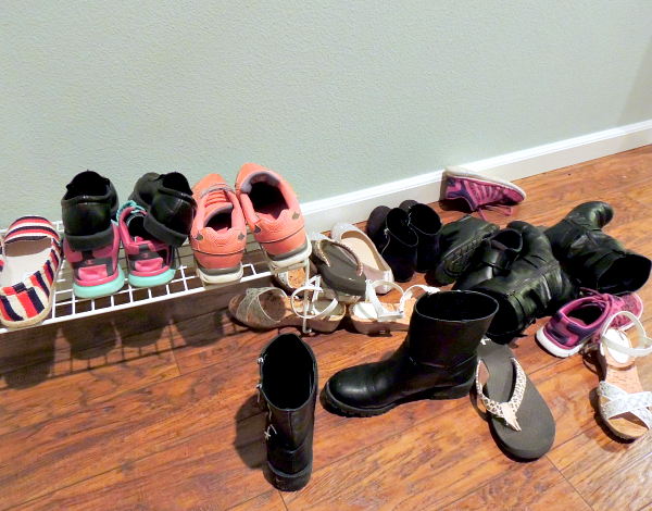 Mess of shoes by front door