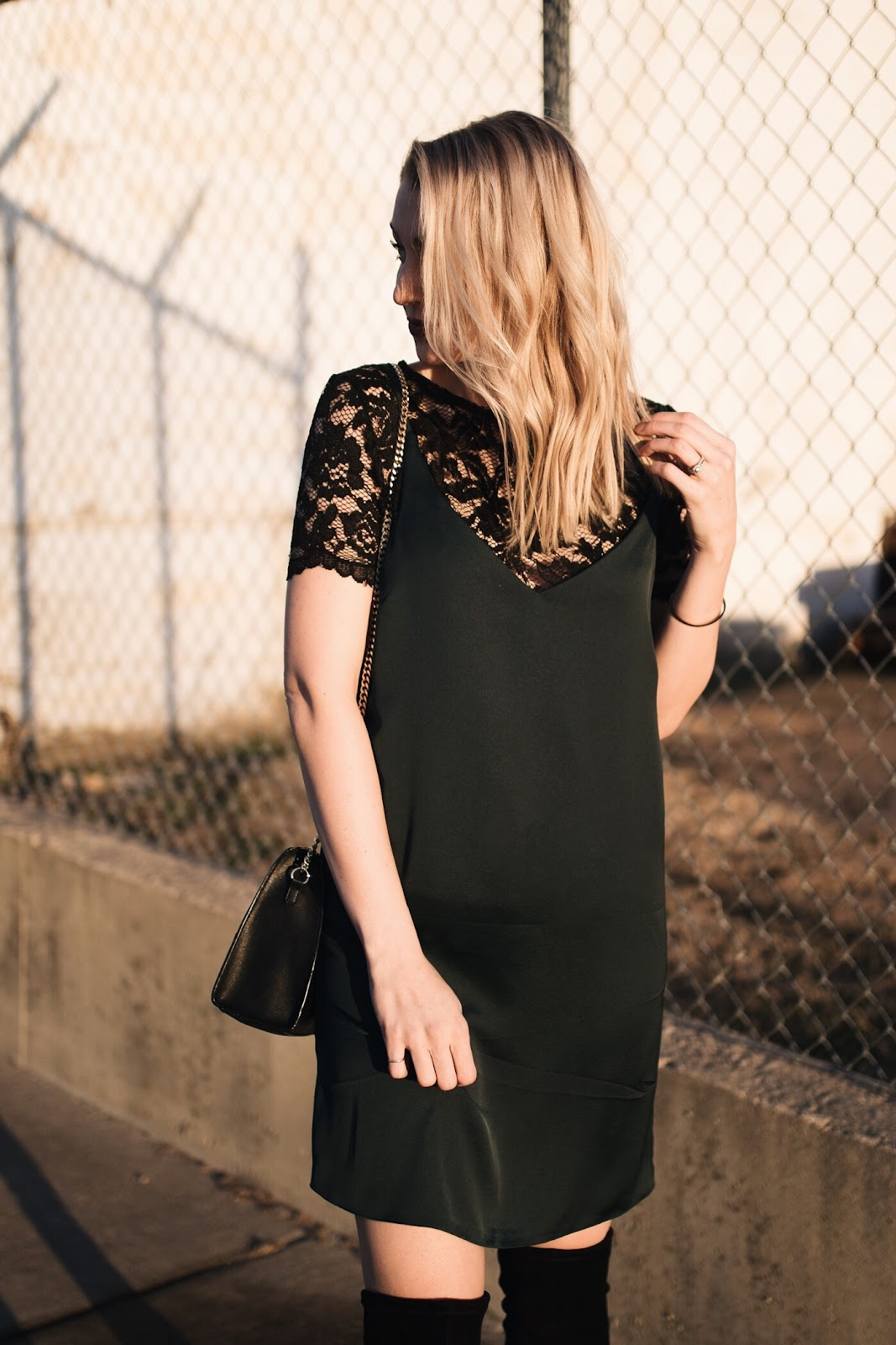 hunter green slip dress over a lace top