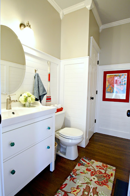 planked white walls in bathroom
