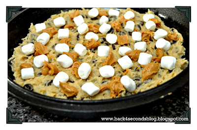 Deep Dish Chocolate Chip Cookie Pie - Ooey gooey with peanut butter and marshmallow filling!! https://backforseconds.com #cookiepie #peanutbutter #pie #castironskillet