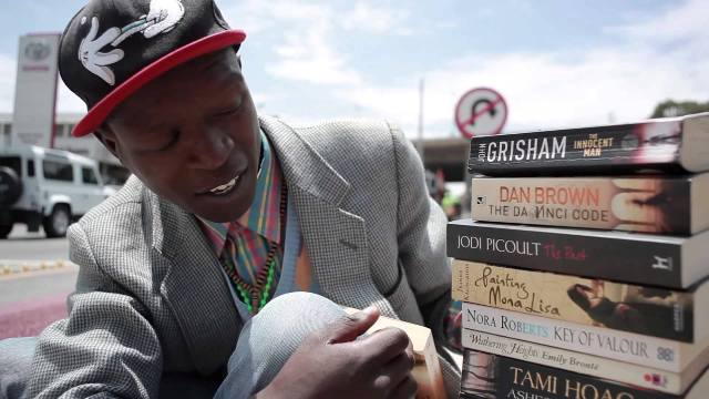 Philani Dladla - The Bookworm on the sidewalk