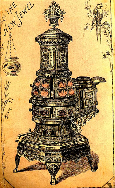 New Jewel stove with flames visible in upper portion. Much ornamentation. Probably coal-fired.
