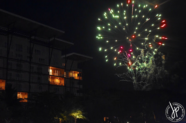night, mid-rise condo building, fireworks