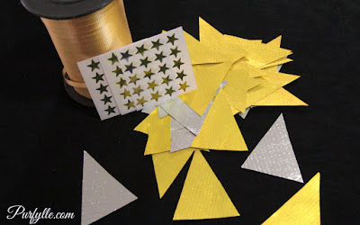 supplies: curling ribbon, star stickers, triangle shapes