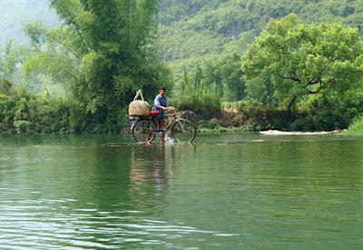 Man crossing yulong river