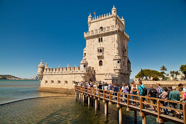 Tourists queuing at the Belem Tower in Lisbon, Portugal