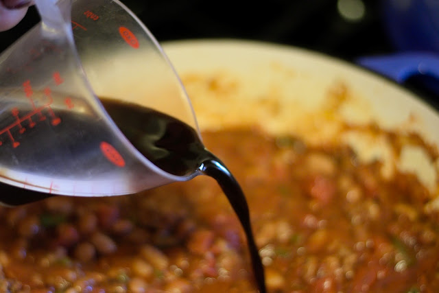 Worcestershire sauce being added to the pot.