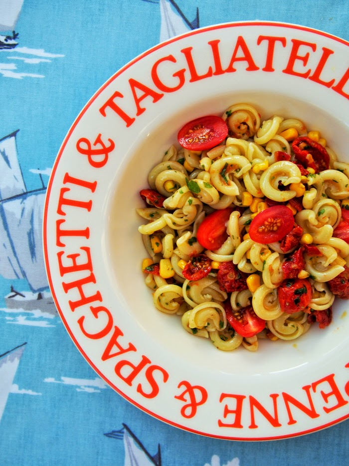 a bowl of summer tomato and corn pasta salad