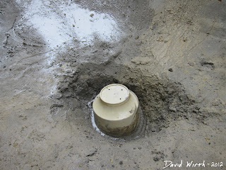 pond pool drain, upside down bucket, water drain into ground