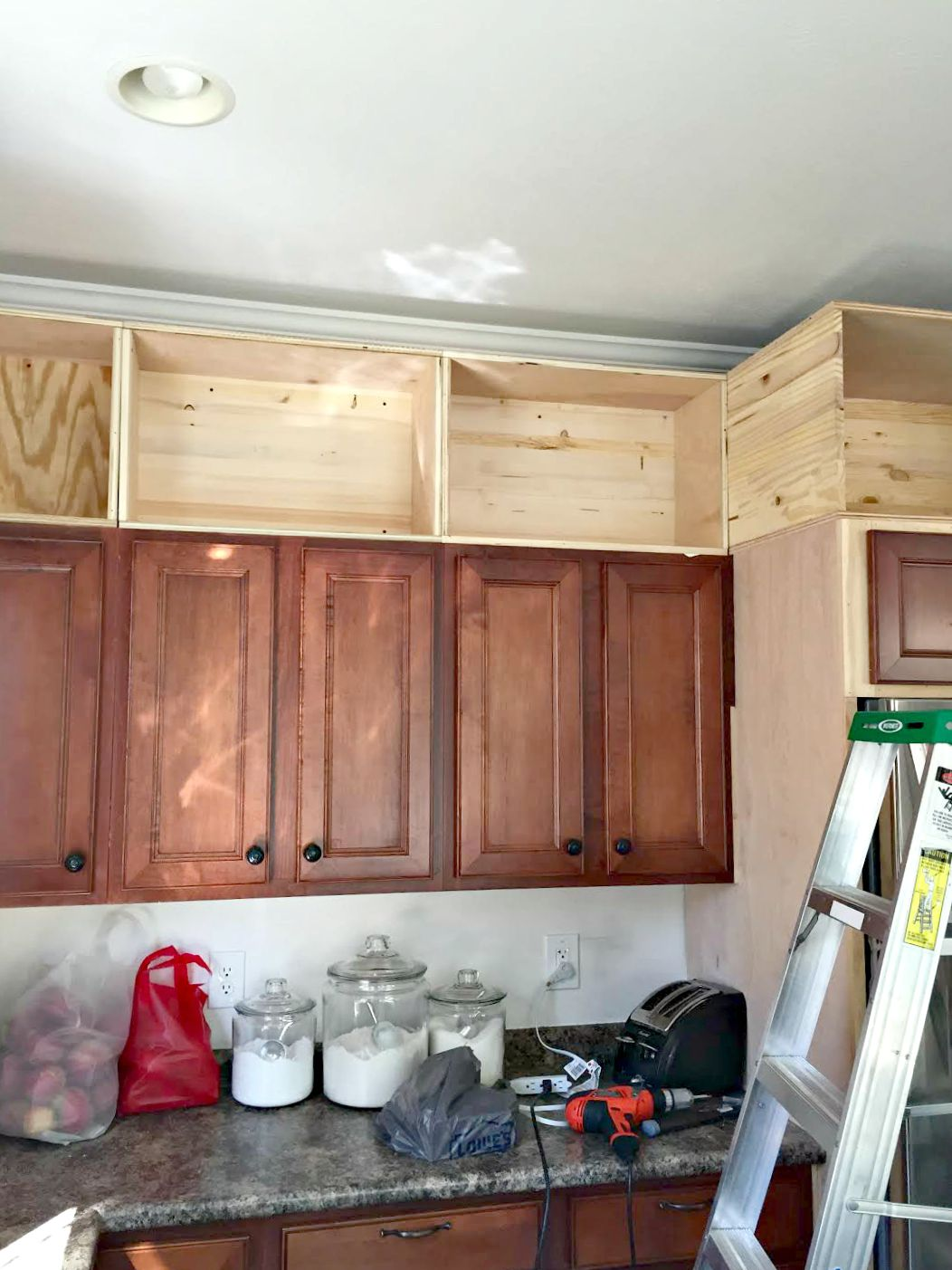 Building Cabinets up to the Ceiling from Thrifty Decor on kitchen shelves instead of cabinets, above kitchen cupboard decorating with antiques ideas, small kitchen ideas with oak cabinets, above kitchen window trim, above kitchen sinks,
