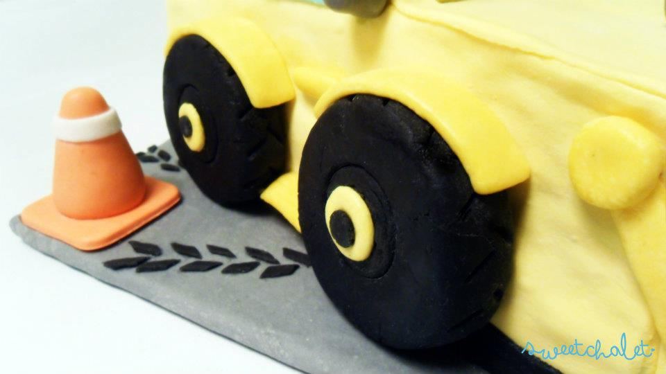 fondant pylon and tire marks added on pavement board
