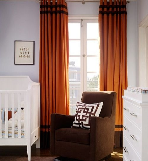 elegant white and brown nursery with orange curtains