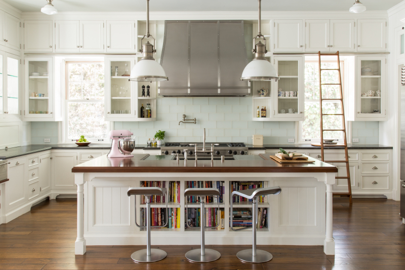 White modern farmhouse kitchen with white cabinets, walnut floors and honed grey granite countertops